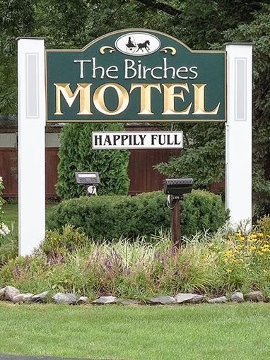 the birches motel sign