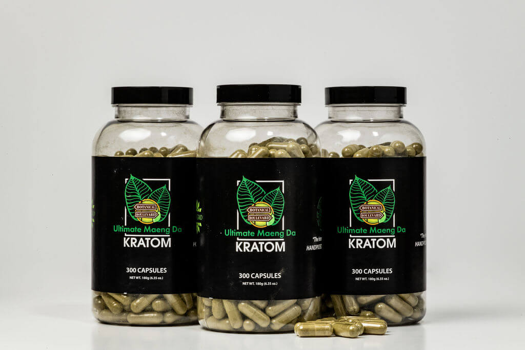 set of green kratom pills sitting on table