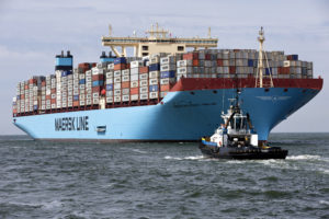 The MV Maersk Mc-Kinney Moller, the world's biggest container ship, arrives at the harbour of Rotterdam August 16, 2013. The 55,000 tonne ship, named after the son of the founder of the oil and shipping group A.P. Moller-Maersk, has a length of 400 meters and cost $185 million. A.P. Moller-Maersk raised its annual profit forecast for the business on Friday, helped by tighter cost controls and lower fuel prices. Maersk shares jumped 6 percent to their highest in 1-1/2 years as investors welcomed a near-doubling of second-quarter earnings at container arm Maersk Line, which generates nearly half of group revenue and is helping counter weakness in the company's oil business. REUTERS/Michael Kooren (NETHERLANDS - Tags: MARITIME TRANSPORT BUSINESS) - RTX12NIU