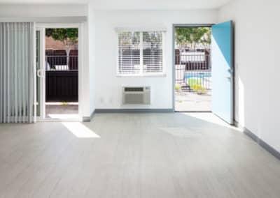Open blue door and empty living room space