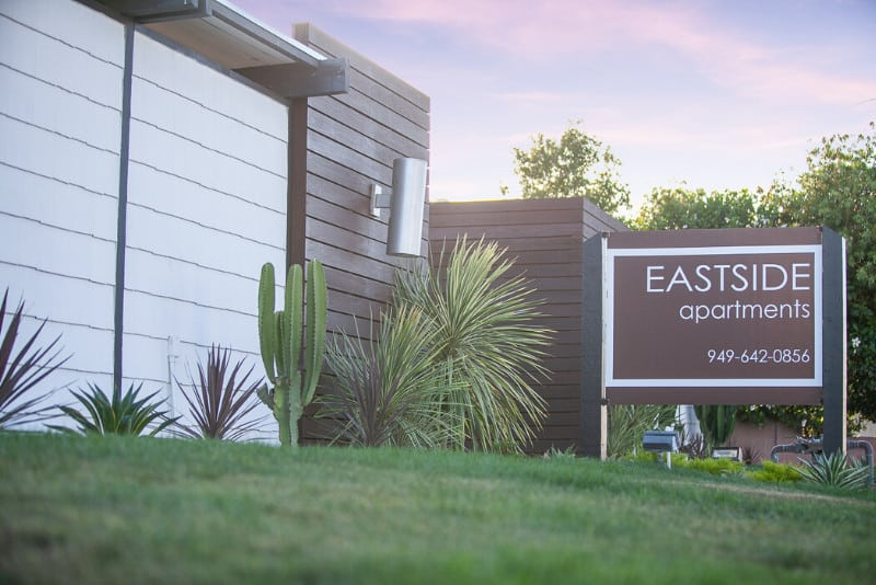 Eastside Apartments Sign next to apartments