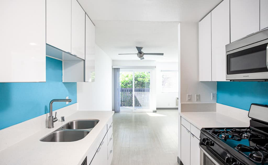 Kitchen with blue walls and white countertops