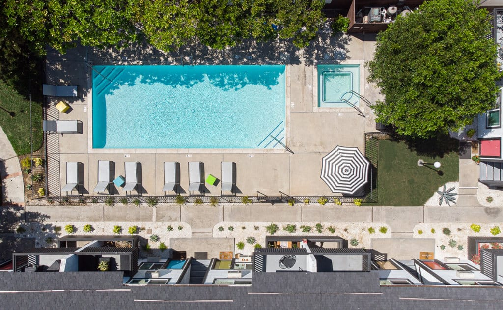 Drone view of a pool with lounge chairs