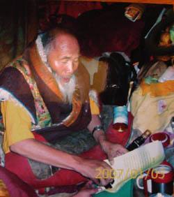 Dharma King Ngagwang Pedma Namgyal Palzangpo stamps his dharma king seal onto the congratulatory letter he wrote to H.H. Dorje Chang Buddha III