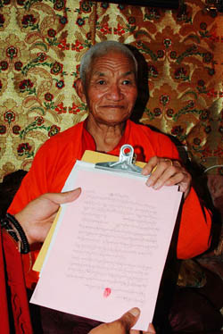 H.E. Dharma King Renzeng Nima holds the recognition letter he wrote recognizing the identity of H.H. Dorje Chang Buddha III