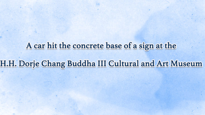 A-car-hit-the-concrete-base-of-a-sign-at-the-H.H.-Dorje-Chang-Buddha-III-Cultural-and-Art-Museum