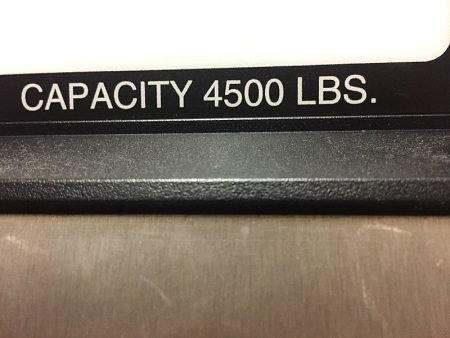 A sign showing a commercial elevator capacity of 4,500 pounds