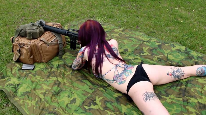 Bobbie Shooting a Colt AR-15 Rifle