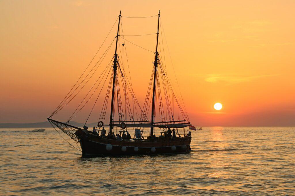 ship on horizon at sunset