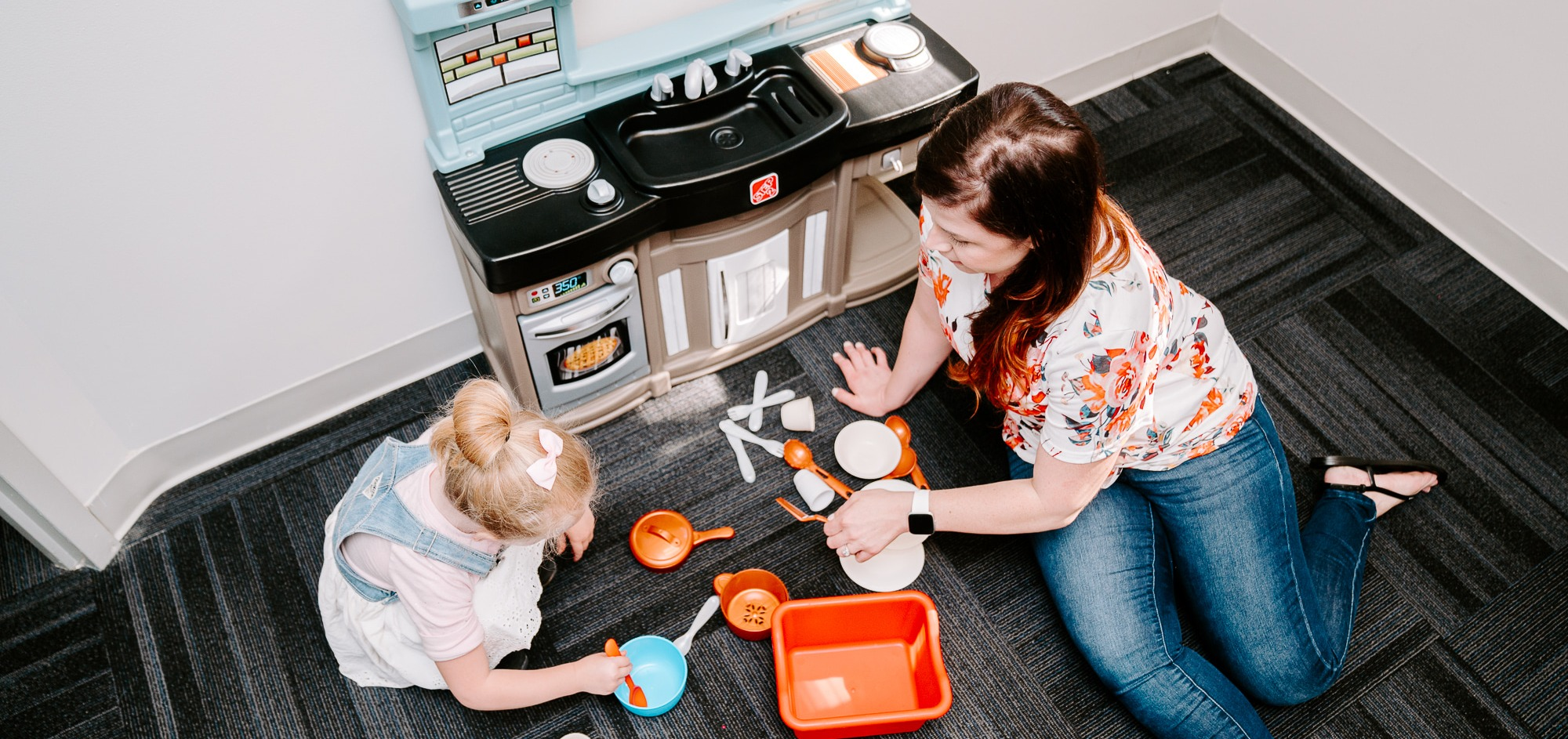 Pretend play with child in toy kitchen