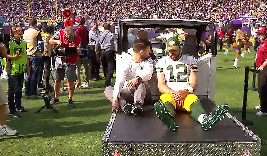 Aaron Rodgers of Green Bay Packers leaves game on a cart