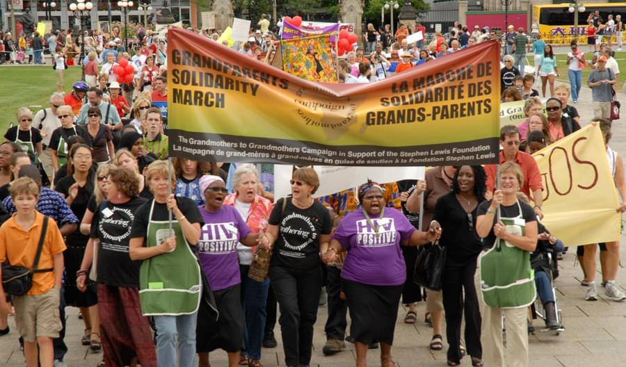 grandmothers marching with banners