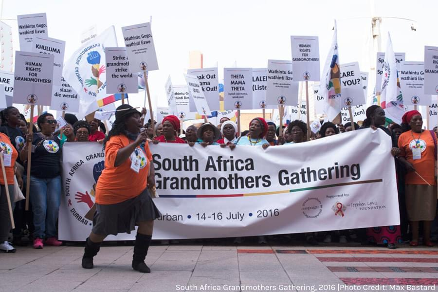 grandmothers marching with banner