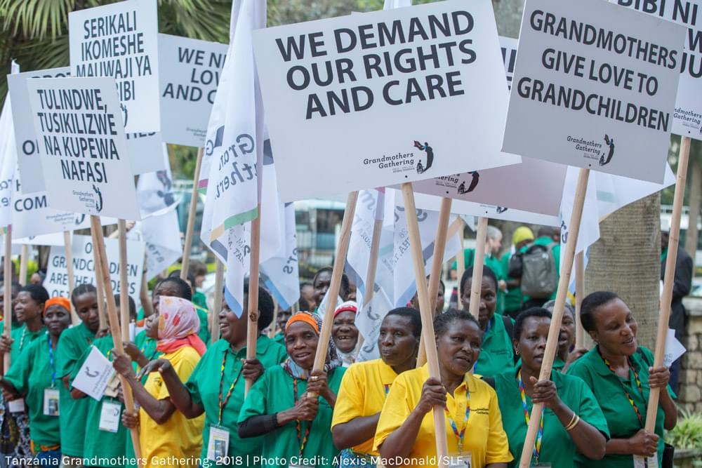 grandmothers with signs reading: we demand our rights and care