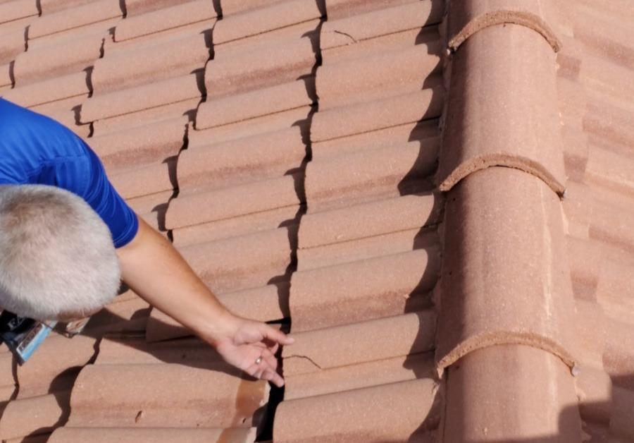 Public Adjuster finds cracked tile causing roof leak.