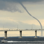 Tornado (waterspout) crossing the causeway in Florida