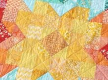 Turn your fabric leftovers into an amazing baby quilt with the Scrappy Posie pattern.