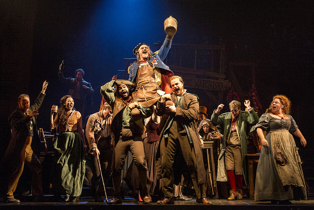 "The company of LES MISÉRABLES performs ""Master of the House"" with J Anthony Crane as 'Thénardier' and Allison Guinn as 'Madame Thénardier.' Photo by Matthew Murphy."