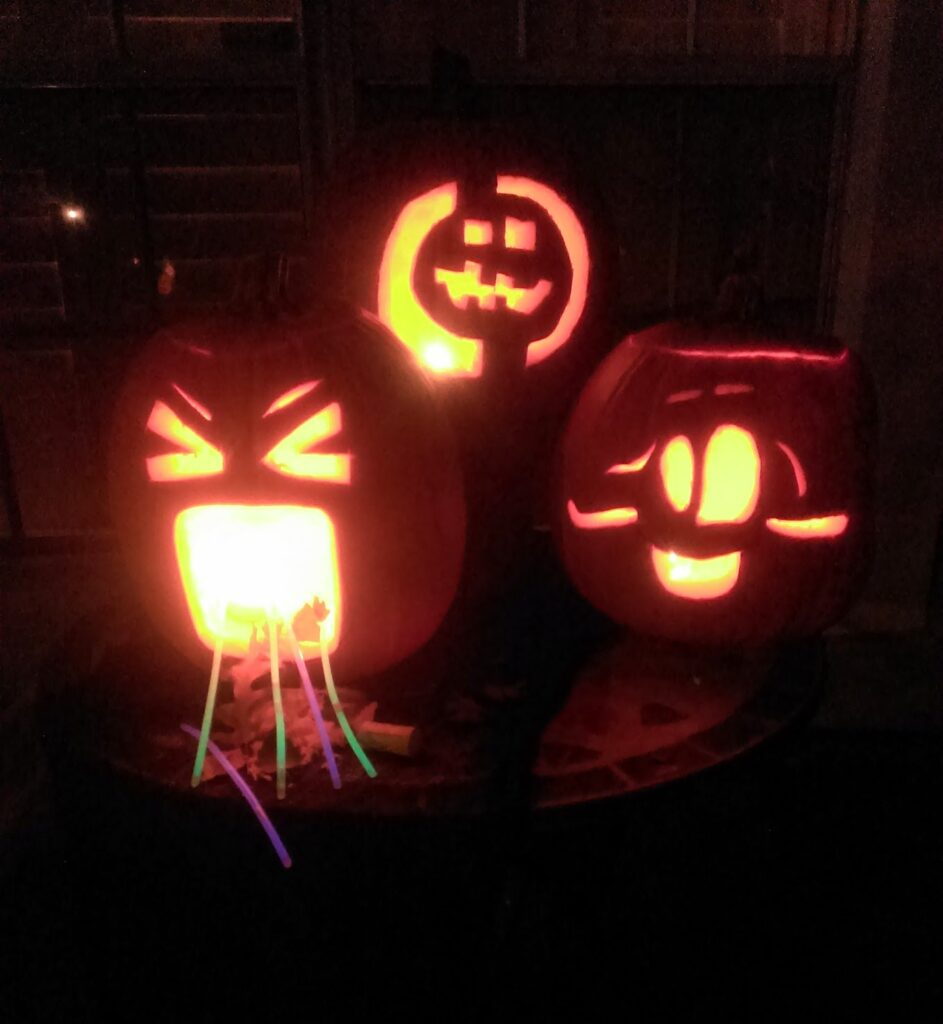 Carved pumpkins with glow sticks