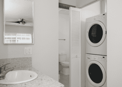 Washer and Dryer across from bathroom sink