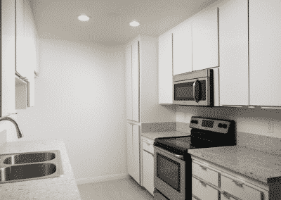 kitchen white cabinets counters appliances