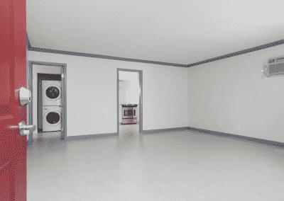 Red door open into living room of apartment