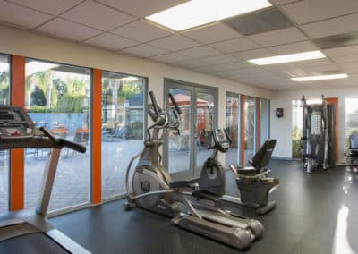 Fitness center with equipment and view of the grounds