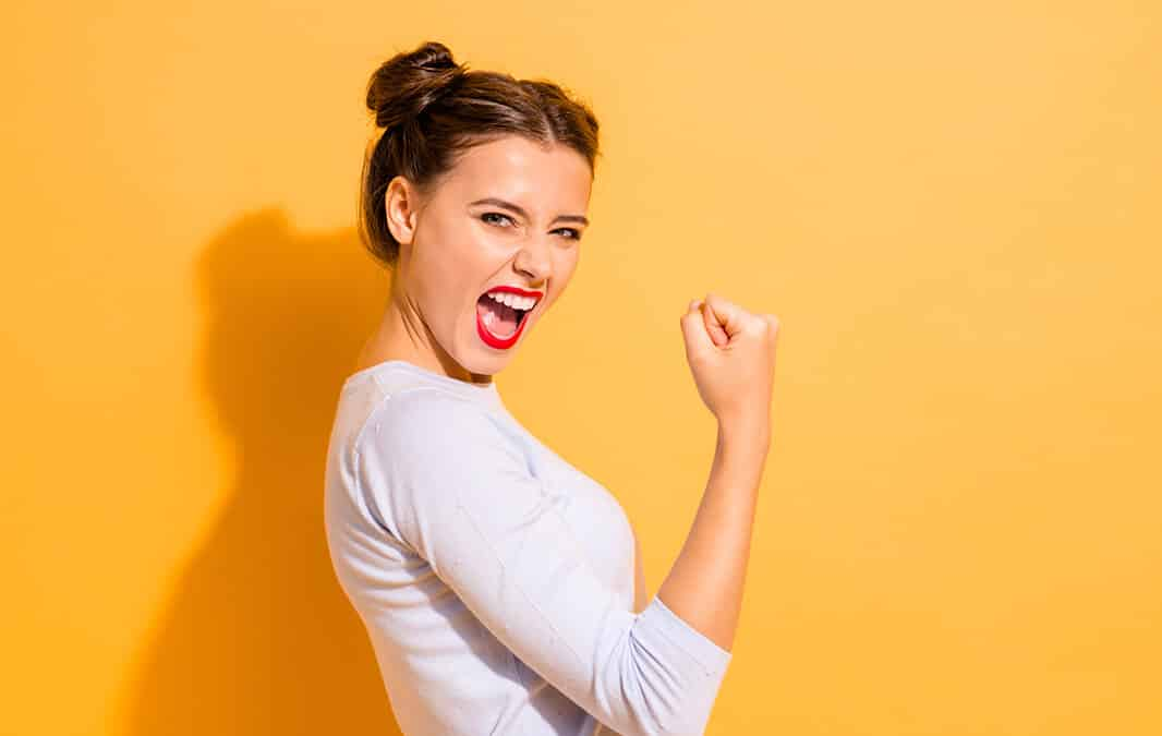 Happy woman with fist up