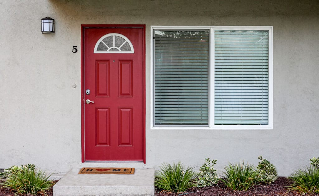 Entrance of Park Del Amo apartment unit with a red door