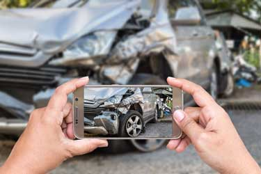 Taking a picture after a car accident