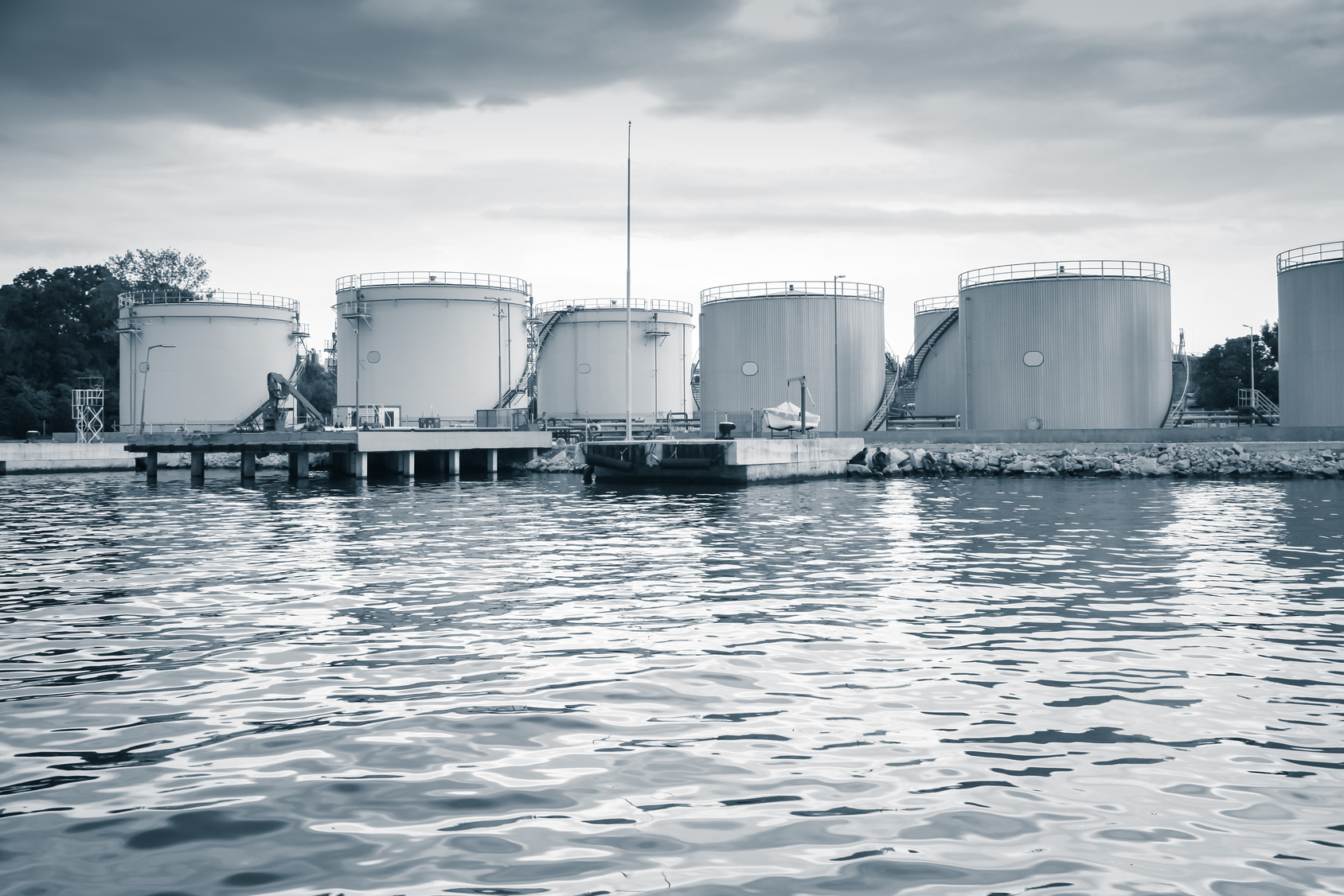 Metal oil tanks on the sea coast
