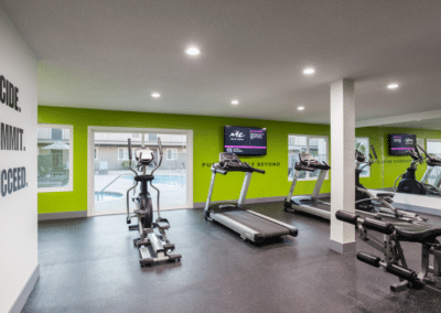 Fitness room with treadmills and cycle machines and tvs