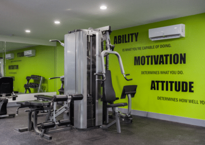Fitness center with fitness equipment and green wall