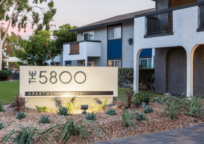 The 5800 apartment homes sign with landscaping