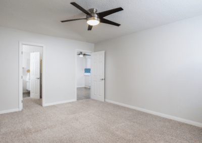 Empty bedroom with ceiling fan