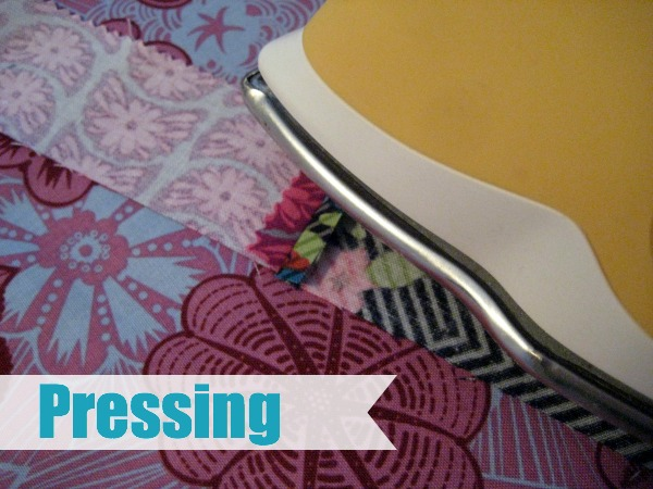 Pressing and Ironing are common terms in sewing but do you know what they mean? Let's breakdown the differences. The Sewing Loft #sewing #ironing #quilting