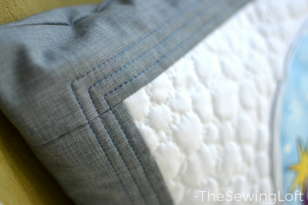 This festive snow globe inspired DIY applique pillow is the perfect addition to my holiday decor.