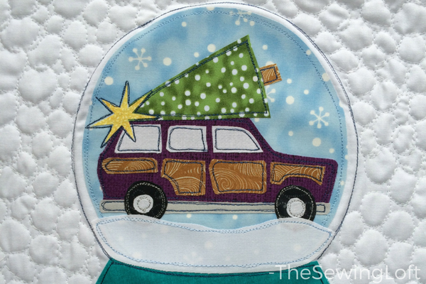 Snow Globe Applique Pillow Woody Design in work. I love the way it looks in the holiday pillow.