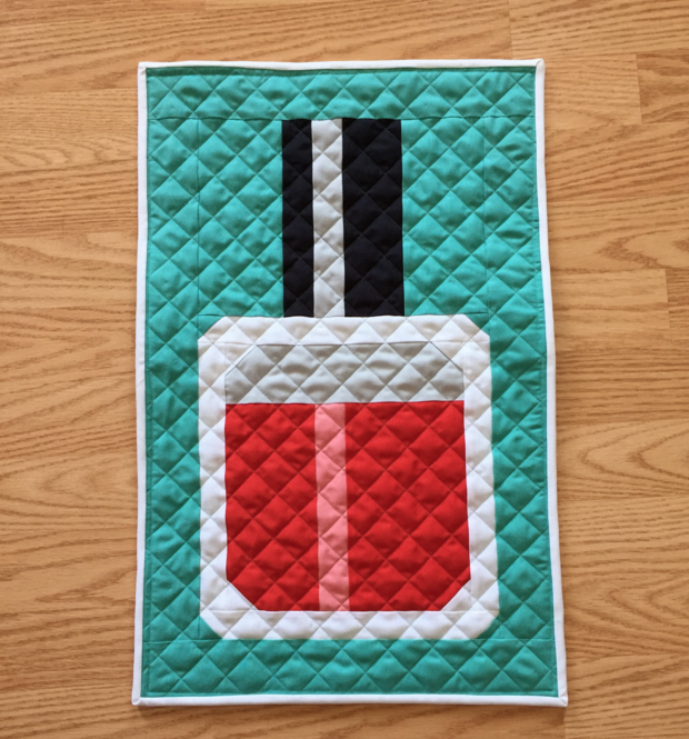 Find this Nail Polish Mini Quilt Pattern by Fat Quarter Shop and more free mini quilt patterns in this fun round up.