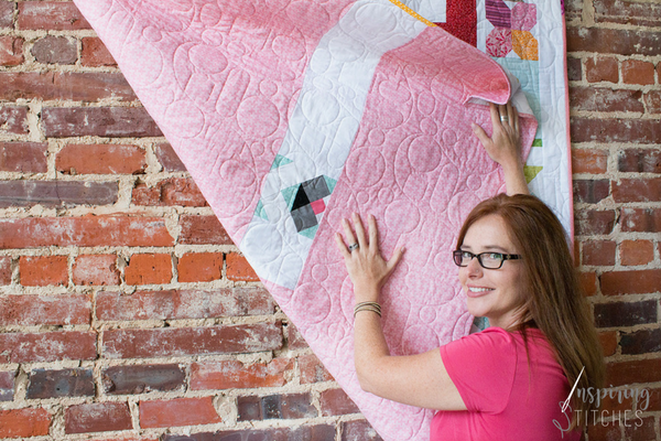 Add your favorite block to back of any quilt for an instant conversation. We love the way the Puppy Love quilt block looks on the back of Inspiring Stitches Heartland Heritage quilt.