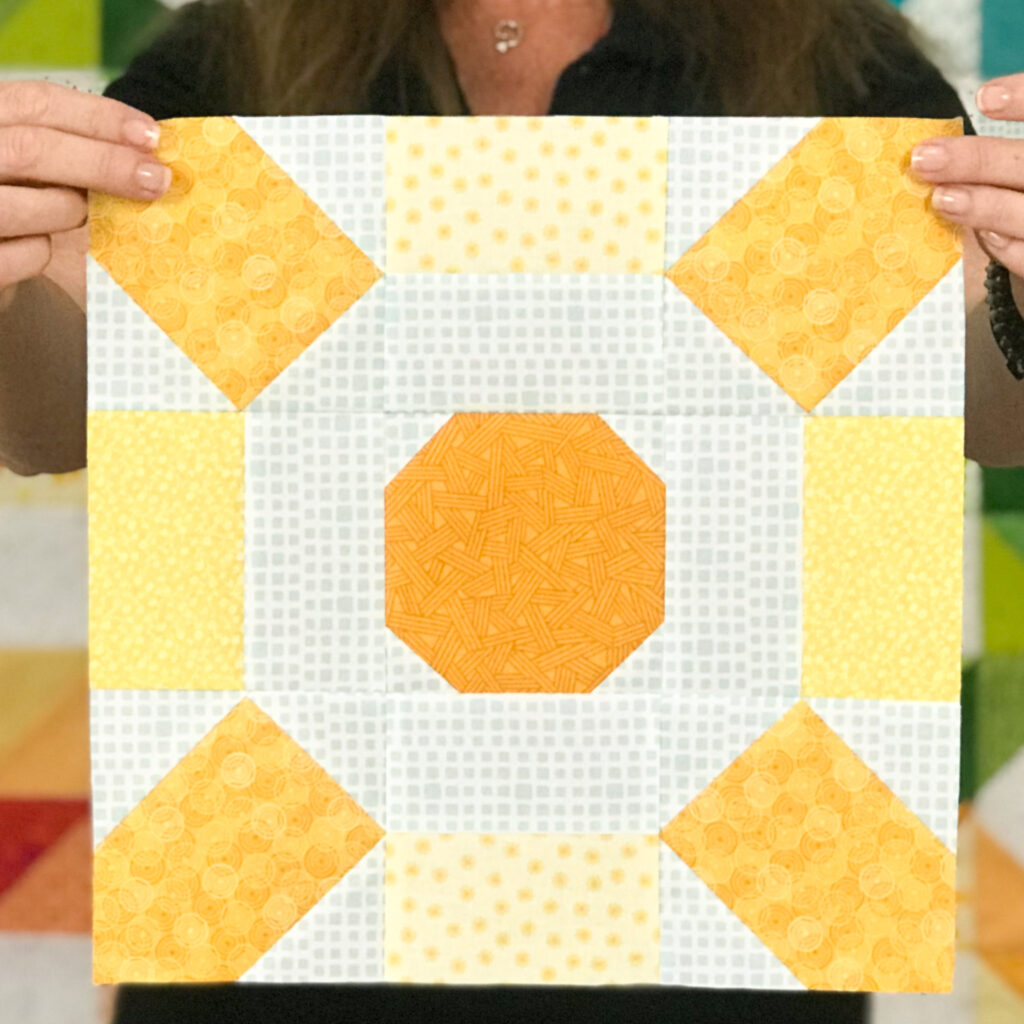 Turn your scraps into rays of sunshine with the Sunburst quilt block pattern by The Sewing Loft.