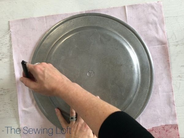 Use a simple serving plate to create a beautiful drawstring jewelry bag. Free video class.