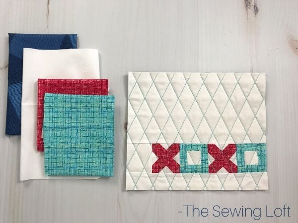 Skip the chocolate and make a sweet mini quilt for someone special this Valentine's Day. Free DIY pattern from The Sewing Loft.