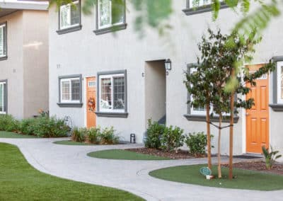 Exterior of apartments with pathway and landscaping