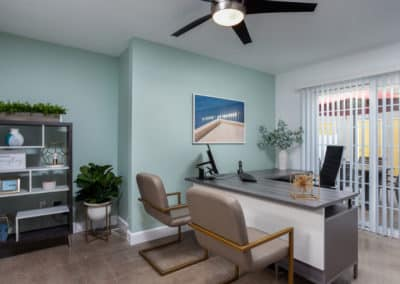 Pointe Pacific Apartments office interior with desk and chairs