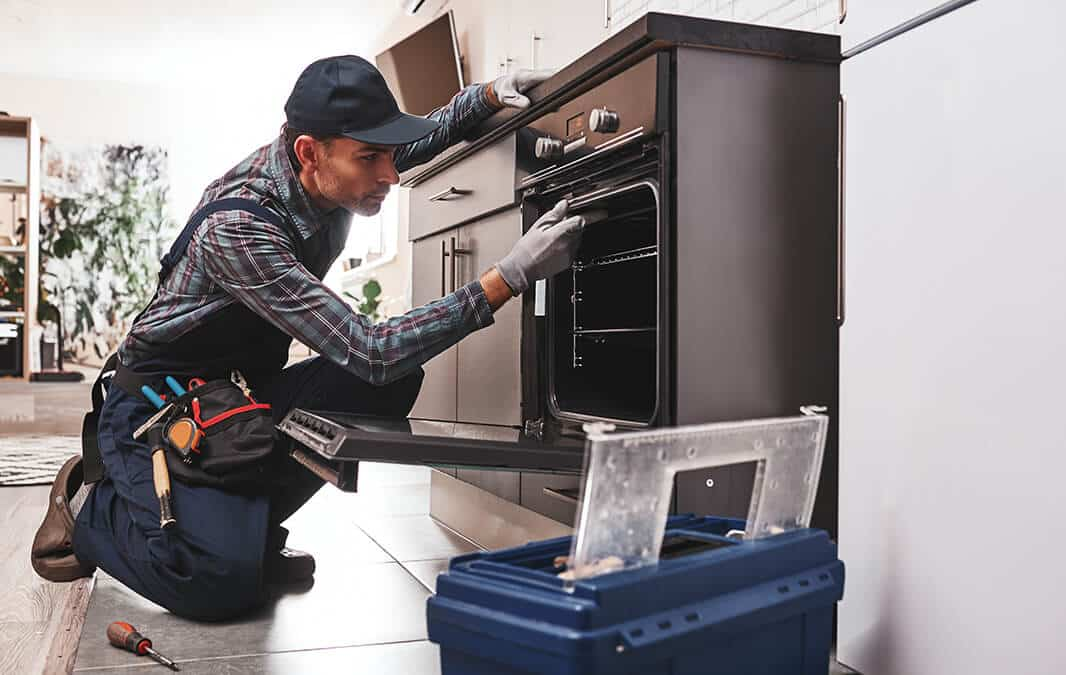 repairman fixing oven