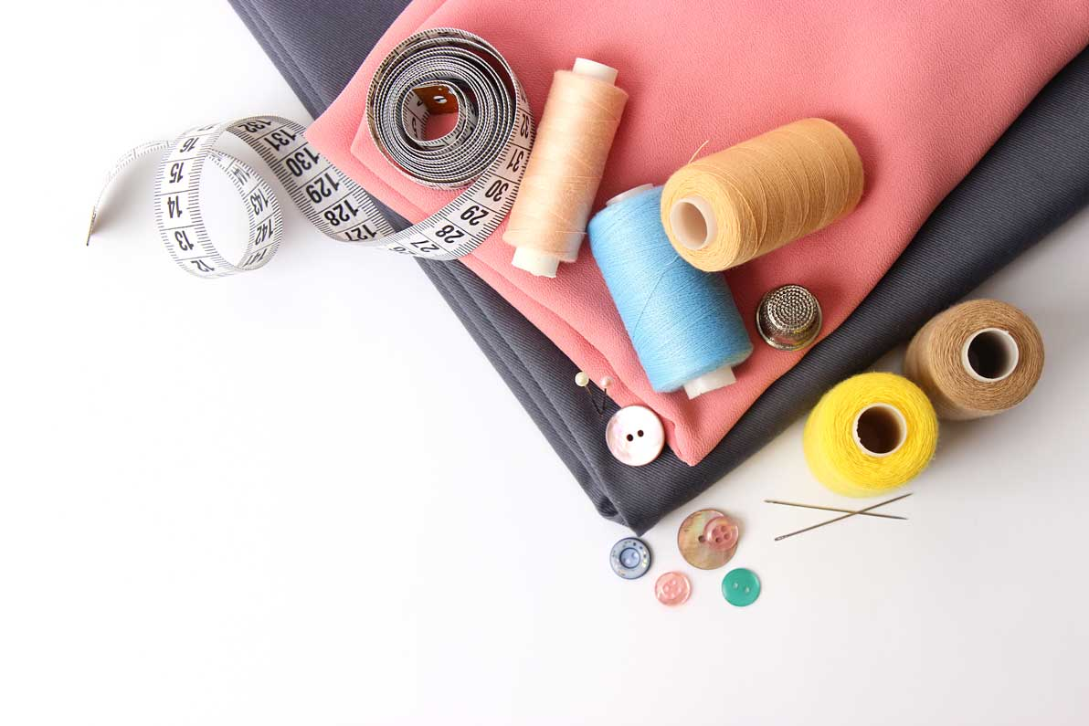 Sewing-accessories-and-fabric-on-a-white-background
