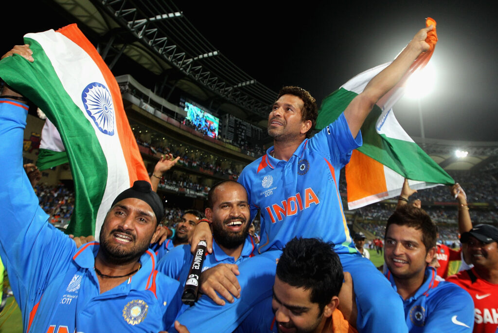 Sachin being carried by his team mates after the world cup victory in 2011