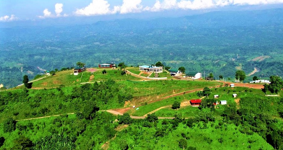 A view from the top of Bandarban hills in Bangladesh. Green mountains and pathways are visible