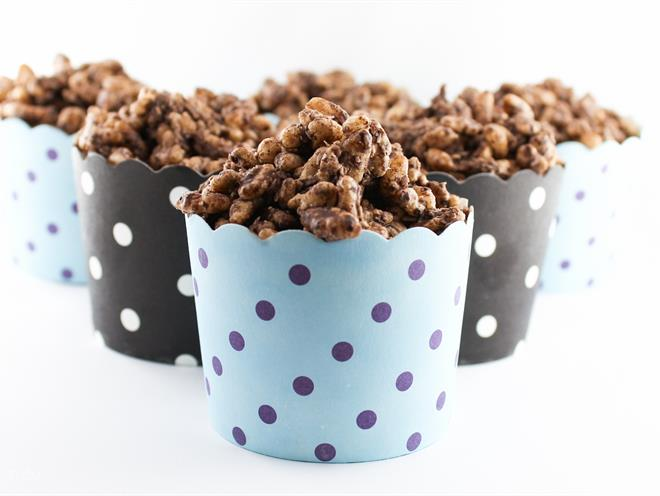 Image of pretty polka dotted blue and black colour cups filled with chocolate crackles